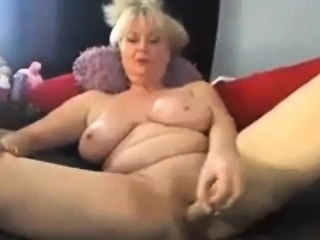 Glum big-busted granny enjoying in heavy fat dildo in excess of webcam