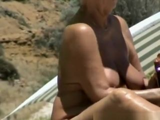 Well-endowed nudist granny